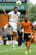 Ahmed Elmohamady wins a header during the Sky Bet Championship match between Wolverhampton Wanderers and Hull City at Molineux, Wolverhampton, England on 16 August 2015. Photo by Alan Franklin.