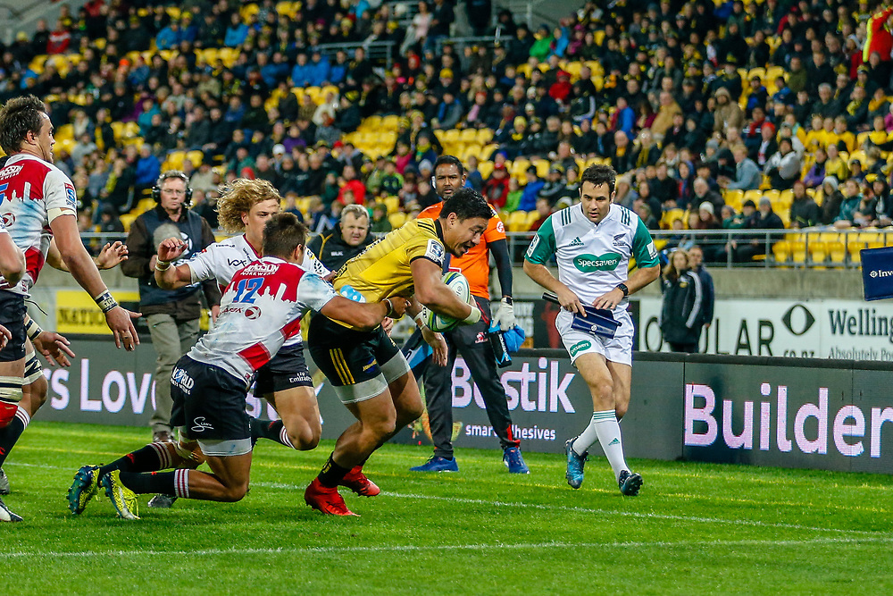 Ben Lam evades tackle during the Super rugby (Round 12) match played between Hurricanes  v Lions, at Westpac Stadium, Wellington, New Zealand, on 5 May 2018.  Hurricanes won 28-19.