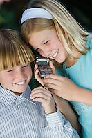 Girl and boy on mobile phone