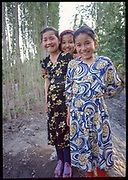 Three Girls, Grape Valley, Taklamakan Desert, China, 1996