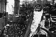 Operation Dynamo, the evacuation of British and Allied troops from Dunkirk 27 May to 3 June 1940. Members of the British Expeditionary Force on a Royal Navy vessel  docking back in Britain