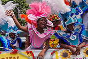 Young Bahamian girls dressed in Junkanoo costumes celebrate graduation in Nassau , Bahamas.