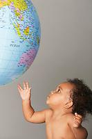Baby Looking at Globe