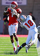 Utah's Shaky Smithson (1) avoids the grasp of UNLV's Marcus Sullivan (18) during a 77-yard punt return for a touchdown during the third quarter of an NCAA college football game at Rice-Eccles Stadium, Saturday, Sept. 11, 2010, in Salt Lake City, Utah. Utah defeated UNLV 38-10. (AP Photo/Colin E. Braley)