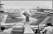 Footograph: Photograph of my right foot clutching a bag of peanuts before a baseball game at Milwaukee's County Stadium.