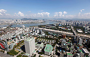 Part of Gangnam area is seen down the Han River (L) in Seoul October 2, 2012. Gangnam is the most upmarket neighbourhood in the South Korean capital. /Lee Jae-Won