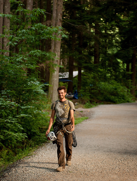 An exhausted Kevin Mohler, from Washington State, walks back to his campsite after spending five hours climbing Parallel Passages on the Grand Wall of the Stawamus Chief.<br /> <br /> <br /> Life along the Stawamus Chief Provincial Park campsite, also known as the Squamish Climber's Campground, where climber's from all over the world come stay while climbing in Squamish.<br /> <br /> Photo Credit: David Buzzard