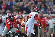 Mississippi defensive end Cameron Whigham (55) vs. Arkansas' Brandon Allen (10) at Vaught-Hemingway Stadium in Oxford, Miss. on Saturday, November 9, 2013. Mississippi won 34-24. (AP Photo/Oxford Eagle, Bruce Newman)