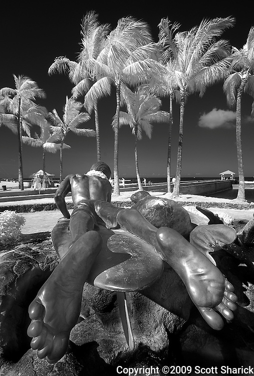 An infrared image of the Surfer and Seal statue in Waikiki.