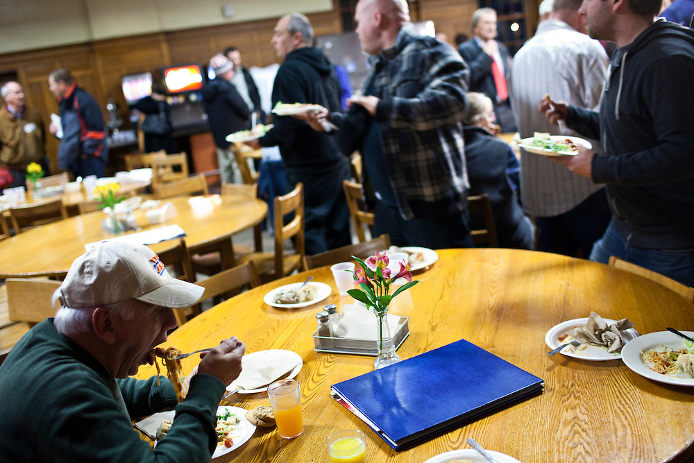 A man eats after Republican presidential candidate Mitt Romney spoke at a spaghetti dinner on Friday, January 6, 2012 in Tilton, NH.