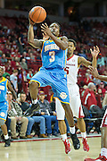 FAYETTEVILLE, AR - NOVEMBER 13:  Treiun Banks #3 of the Southern University Jaguars goes up for a layup in front of Anthlon Bell #5 of the Arkansas Razorbacks at Bud Walton Arena on November 13, 2015 in Fayetteville, Arkansas.  The Razorbacks defeated the Jaguars 86-68.  (Photo by Wesley Hitt/Getty Images) *** Local Caption *** Treiun Banks; Anthlon Bell