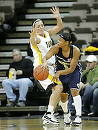 28 NOVEMBER 2007: Georgia Tech guard Jill Ingram (5) passes the ball around Iowa guard Abby Emmert (3) in the first half of Georgia Tech's 76-57 win over Iowa in the Big Ten/ACC Challenge at Carver-Hawkeye Arena in Iowa City, Iowa on November 28, 2007.