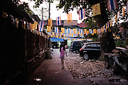 KADEEJEEN, BANGKOK, THAILAND, DECEMBER 2012:..Night life in Kadeejeen, Dec 2012. ..The Kadeejeen neighbourhood comprises six communities  Wat Kalaya, Kudeejeen, Wat Prayurawong, Wat Bupparaam, Kudee Khao and Roang Kraam...Ever since the Thonburi era (in the 17th Century), these historic neighbourhoods have maintained the diverse cultural heritage of three religions and four beliefs (Theravada Buddhism, Mahayana Buddhism, Christianity and Muslim) while coexisting in peaceful harmony...The neighbourhood is still characterised by Bangkok's traditional urbanism which is that of a fine-grained, religious establishment-centred urban structure with close-knit social cohesion. ©Giulio Di Sturco/Reportage by Getty Images.