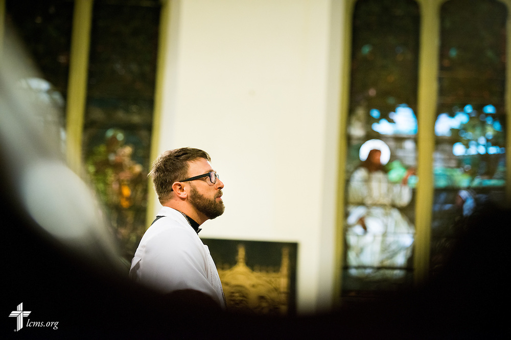 The Rev. Adam DeGroot, new national missionary and pastor at Shepherd of the City Lutheran Church, a church plant and focus of Philadelphia Lutheran Ministries, prays during Vespers at Logos Lutheran on Sunday, Nov. 1, 2015, in Philadelphia.  LCMS Communications/Erik M. Lunsford