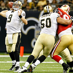 August 12, 2011; New Orleans, LA, USA; New Orleans Saints quarterback Drew Brees (9) during the first half of a preseason game against the San Francisco 49ers at the Louisiana Superdome. Mandatory Credit: Derick E. Hingle
