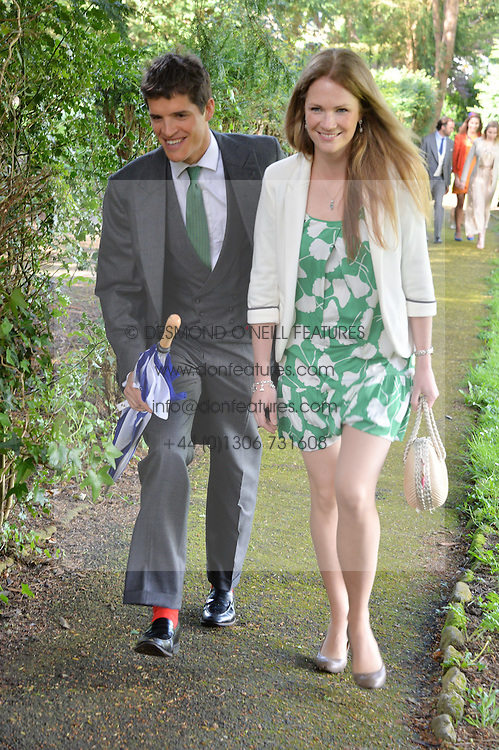TOM & LADY IONA HEWITT at the wedding of Princess Florence von Preussen second daughter of Prince Nicholas von Preussen to the Hon.James Tollemache youngest son of the 5th Lord Tollemache held at the Church of St.Michael & All Angels, East Coker, Somerset on 10th May 2014.