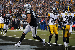 OAKLAND, CA - DECEMBER 09: Tight end Derek Carrier #85 of the Oakland Raiders scores a touchdown against the Pittsburgh Steelers during the fourth quarter at the Oakland Coliseum on December 9, 2018 in Oakland, California. The Oakland Raiders defeated the Pittsburgh Steelers 24-21. (Photo by Jason O. Watson/Getty Images) *** Local Caption *** Derek Carrier