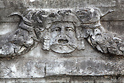Mask and garland frieze, Aphrodisias, Aydin, Turkey. The Sculpture School at Aphrodisias was an important producer of carved marble sarcophagi and friezes from the 1st century BC until the 6th century AD. The city has many examples of mask and garland friezes, consisting of heads of gods or theatrical masks between hanging garlands of leaves, fruit and flowers. This example shows an old man with an open mouth. The best examples of these were from the Portico of Tiberius, the Southern portico of the Agora. Aphrodisias was a small ancient Greek city in Caria near the modern-day town of Geyre. It was named after Aphrodite, the Greek goddess of love, who had here her unique cult image, the Aphrodite of Aphrodisias. The city suffered major earthquakes in the 4th and 7th centuries which destroyed most of the ancient structures. Picture by Manuel Cohen