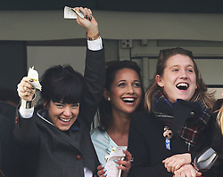 Singer Lily Allen (left) celebrates with friends as the winner of the Cheltenham Gold Cup crosses the line  at the Cheltenham Festival, United Kingdom, Friday, 14th March 2014. Picture by Stephen Lock / i-Images