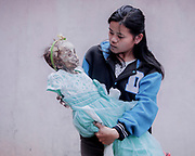 Ruslin Karaeng (30) with her daughter, Ditha, who suddenly passed away from an illness four years ago when she was just 1yr old.<br /> <br /> Ma'nene is a tradition that takes place in August after harvest where the bodies of the dead loved ones are exhumed to be cleaned, groomed and dressed. For most, it's a bittersweet moment, a chance to reunite and physically see and touch and reconnect with loved ones who had passed on.