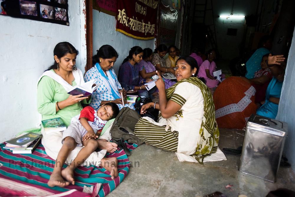 Muslim women collecting and spending time at the community center in the Kherwadi area, in Mumbai, India, on Monday February 10, 2009. Photographer: Prashanth Vishwanathan