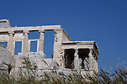 ATHENS, GREECE - APRIL 17 : A low angle view of the western side of the Erechtheum with the Porch of the Caryatids and the West facade, on April 17, 2007, in Athens, Greece. The Erechtheum was built on the Acropolis, between 421 and 405 BC, in the Ionic Order. The famous Caryatid porch, with 6 sculptures of maidens replacing the columns, faces South towards the Parthenon. (Photo by Manuel Cohen)