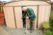 The Bulb Guy Rich Santoro pulls out his HoundDog bulb planting tool from his shed as he maintains his 10,000 Spring bulb garden at his home in Berryessa, San Jose, California, on March 17, 2014. The tool has helped Santoro plant more than 45,000 bulbs over the past 30 years. (Stan Olszewski/SOSKIphoto)