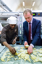 © Licensed to London News Pictures. 30/05/2017. London, UK. Leader of Liberal Democrats TIM FARRON helps making pastry on a visit to Comptoir Gourmand Bakery shop in Bermondsey, London with former Bermondsey and Old Southwark MP Sir Simon Hughes on Tuesday, 30 May 2017. Photo credit: Tolga Akmen/LNP