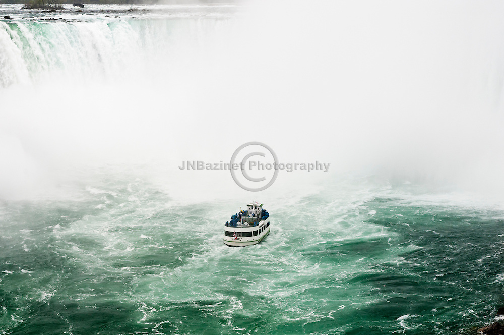The Maid of the Mist approaching Horseshoe Falls in Niagara Canada