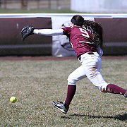 Caravel Academy Outfielder Nicole Marcon (9) attempts to catch a fly ball in the out field during varsity scheduled game between Caravel Academy and The Delmar Wildcats Saturday, April 4, 2015, at Caravel Athletic Field in Bear Delaware.