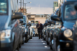 © Licensed to London News Pictures. 18/01/2018. London, UK. Black Cab drivers block London Bridge to protest against minicab firm Uber's continued operation in London. Transport for London revoked Uber's license in September 2017 but the decision is currently under appeal. Photo credit: Rob Pinney/LNP