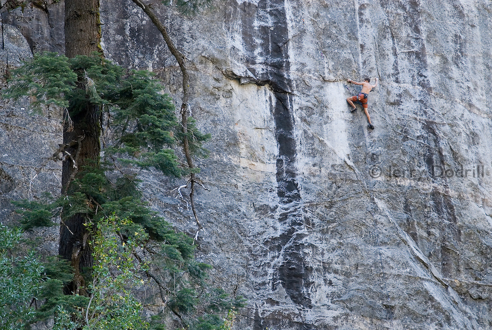 """Brad Johnson climbing """"Catch and Release"""" 5.13b, at The Lost World, Sonora Pass, California"""