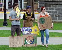 Bar Harbor, USA. 29 April, 2017. Protesters gather on the Village Green for the Downeast Climate March, a sister march to the People's Climate March in Washington, D.C.