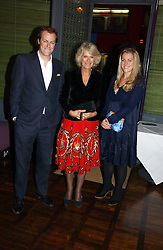HRH THE DUCHESS OF CORNWALL and her son TOM PARKER BOWLES and daughter LAURA LOPES at a party to celebrate the publication of 'The year of Eating Dangerously' by Tom Parker Bowles held at Kensington Place, 201 Kensington Church Street, London on 12th october 2006.<br />