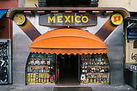 """NAPLES, ITALY - 20 NOVEMBER 2018: The storefront of Bar Mexico in Piazza Dante is seen here in Naples, Italy, on November 20th 2018.<br /> <br /> My Brilliant Friend (Italian: L'amica geniale) is an Italian-American drama television miniseries based on the novel of the same name by Elena Ferrante. The series follows the lives of two perceptive and intelligent girls, Elena (sometimes called """"Lenù"""") Greco and Raffaella (""""Lila"""") Cerullo, from childhood to adulthood and old age, as they try to create lives for themselves amidst the violent and stultifying culture of their home – a poor neighborhood on the outskirts of Naples, Italy. My Brilliant Friend is a co-production between American premium cable network HBO and Italian networks RAI and TIMvision"""