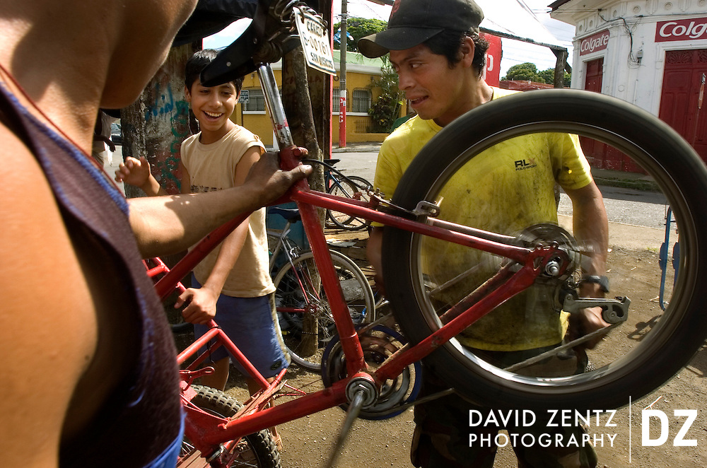Young Nicaraguan men work on bicycles at a repair shop in Jinotepe, Nicaragua in October, 2004.