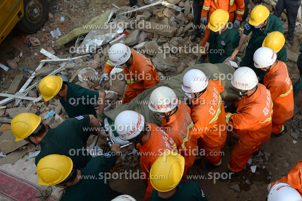 A survivor is rescued at the accident scene after 12 hours of an explosion in Huludao City, northeast China's Liaoning Province, June 12, 2015. Three people were killed and one remains trapped in the debris after an explosion at a residential building on Friday morning in northeast China's Liaoning Province. EXPA Pictures &copy; 2015, PhotoCredit: EXPA/ Photoshot/ Pan Yulong<br /> <br /> *****ATTENTION - for AUT, SLO, CRO, SRB, BIH, MAZ only*****