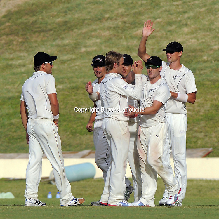 Kane Williamson and Brendon McCullum pleased with wicket of Assad Fudadin - Day 3 of the first test West Indies v New Zealand at Sir Vivian Richards Stadium, Antigua, West Indies.<br /> 27 July 2012. Photo: Randy Brooks/Photosport.co.nz