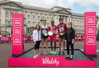 Andy Butchart (second place), Sir Mo Farah (first place), and Nick Goolab (third place) pose together on the podium, alongside Dame Jess Ennis-Hill and Judy Parfitt, Director of People at Vitality, with their respective salvers in the British Championships 10,000 Road Race Men as part of The Vitality London 10,000, Monday 27 May 2019.<br /> <br /> Photo: Thomas Lovelock for The Vitality London 10,000<br /> <br /> For further information: media@londonmarathonevents.co.uk