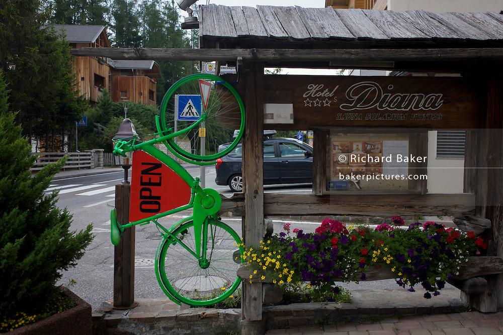 Green bike advertises a local hotel in the Dolomites near La Villa, in Alta Badia, south Tyrol, Italy.