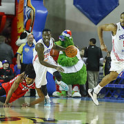 Delaware 87ers Guard LaQuentin Miles (20) dribbles the ball up the floor as Maine Red Claws Guard Sherwood Brown (15) falls in the first half of a NBA D-league regular season basketball game between the Delaware 87ers and the Maine Red Claws (Boston Celtics) Friday, Dec. 12, 2014 at The Bob Carpenter Sports Convocation Center in Newark, DEL