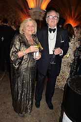 DAME VIVIEN DUFFIELD and LORD HINDLIP at Save the Children's spectacular, black tie Winter Gala, a festive fundraising event held at London's Guildhall. Guests were transported into the magical world of the much-celebrated British novelist, Roald Dahl, in celebration of his centenary, for a marvellous evening of fine dining and gloriumtious entertainment to raise money to help transform children's lives across the world and here in the UK.