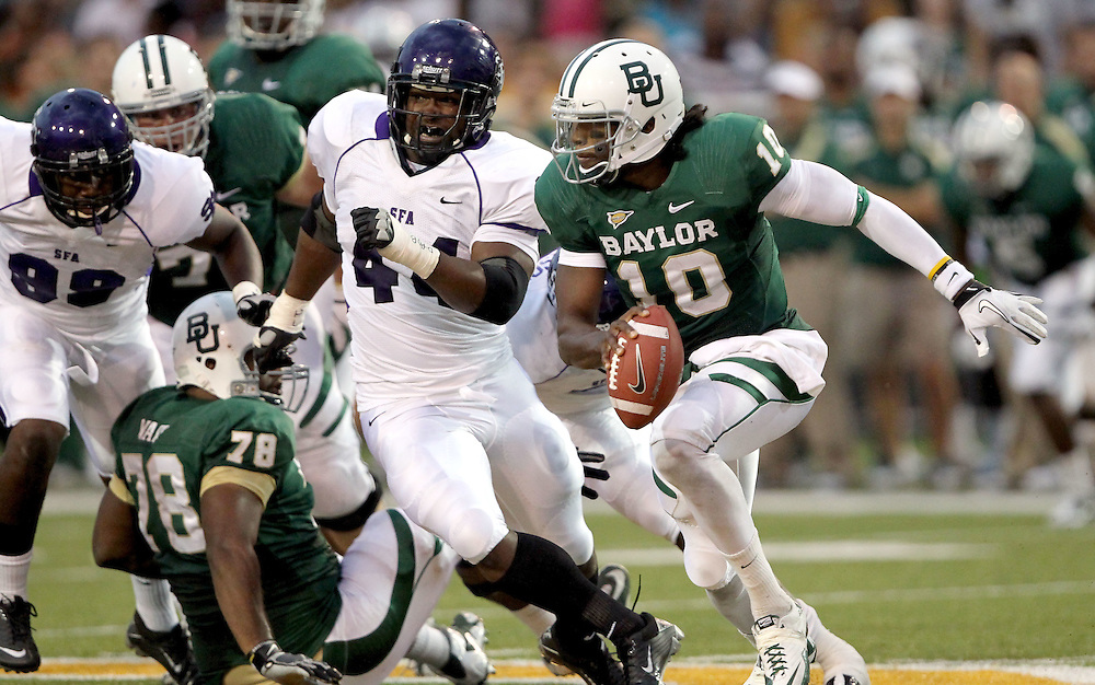 Baylor quarterback Robert Griffin III (10) is chased out of the pocket by Stephen F. Austin defensive lineman Keith Watson (44) during an NCAA college football game, Saturday, Sept. 17, 2011, in Waco, Texas. Baylor won 48-0.