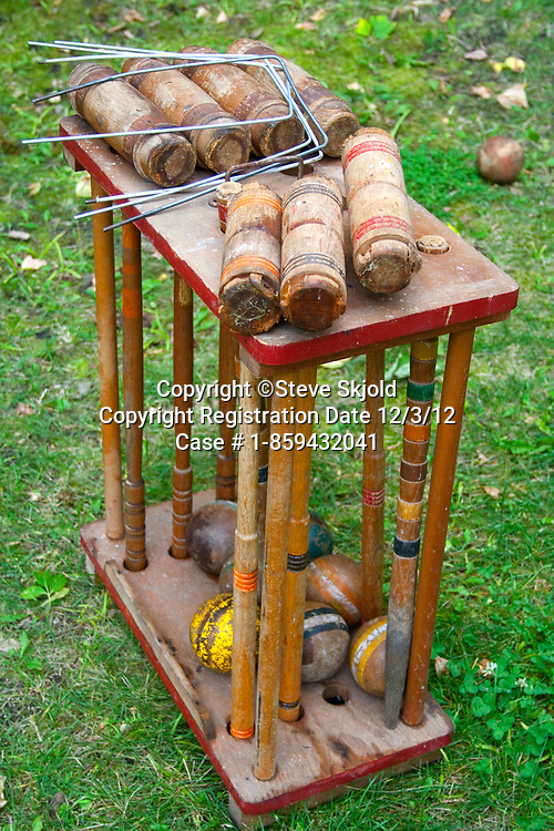 Portrait of a well used wooden croquette set. Clitherall Minnesota MN USA