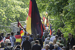 May 5, 2018 - Neustadt, Rhineland-Palatinate, Germany - Participants of the 'Patriotic Hike' walk up the hill to the Haibach Castle, carrying German flags. The New Hambach Festival, organised by national-conservative and members of the new right, took place at the Hambach Castle. Organised by controversial CDU (Christian Democratic Union of Germany) member and AfD (Alternative for Germany) sympathiser Max Otte, it sees controversial speakers such as Thilo Sarrazin, Vera Lengsfeld and Federal spokesman for the AfD Jorg Meuthen. The festival was preceded by a 'Patriotic Hike' to the castle, which saw around 500 members walk to the castle. It was hassled by counter protesters at the foot of the castle. The original Hambach Festival in 1832 is seen as one of the main events leading to German unity and democracy. (Credit Image: © Michael Debets/Pacific Press via ZUMA Wire)