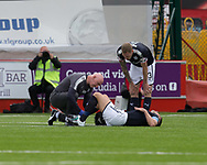 12th August 2017, SuperSeal Stadium, Hamilton, Scotland; SL Football league Hamilton Academicals versus Dundee; Dundee's Darren O'Dea receives treatmenr from physio Gerry Docherty while Kevin Holt looks on