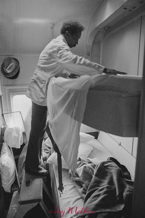 The Amtrak Floridian passenger train that operated between Chicago, Illinois and Miami, Florida ceased operation in 1979.  It was the last passenger train that serviced Louisville. Kentucky as well.  These photographs document the final days for the workers in the Chicago Yards, the Amtrak employees aboard the train, an engineer,, W.C. Roddy, that drove the train between Louisville and Bowling Green, KY and the passengers who enjoyed riding the rails.<br /> <br /> Pictured:  Thomas Washington, a porter on the train, makes up a two-person sleeper as the train rolls through Georgia.