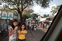 Schoolgirls make way home after class in Coron, Philippines. Copyright 2015 Reid McNally.