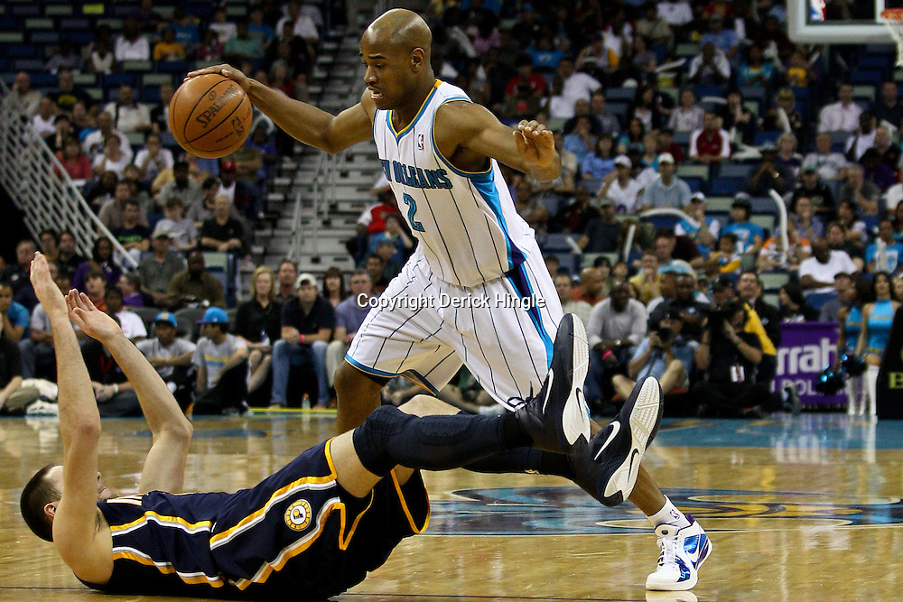 April 3, 2011; New Orleans, LA, USA; New Orleans Hornets point guard Jarrett Jack (2) drives past Indiana Pacers power forward Tyler Hansbrough (50) during the second quarter at the New Orleans Arena.    Mandatory Credit: Derick E. Hingle
