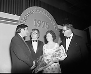 Housewife Of The Year Final.        (J91).1975..25.11.1975..11.25.1975..25th November 1975..The Housewife Of The Year Final took place today at Jury,s Hotel,Ballsbridge,Dublin. The event was sponsored by Mc Donnells, Calor/Kosangas and Woman's Way magazine. The show was compered by Mr Mike Murphy from RTE..The finalists were:.Mrs Geraldine Cronin,Nenagh,Co Tipperary..Mrs Deirdre Dolan,Passage West,Co Cork..Mrs Barbara Hartigan,Castleconnell,Co Limerick..Mrs Frances Twomey,Castlebar, Co Mayo..Mrs Susanne Browne,Lifford, Co Donegal..Mrs Lilian Murphy, Dunshaughlin,Co Meath..Mrs Eileen Jones,Donabate, Co Dublin..The sevenfinalists were selected from a group of eighty four entrants.The cookery section was judged by Paula Daly,McDonnell's Good Food Kitchen,Liz Boyhan,Calor Kosangas and Honor Moore, Woman's Way. .Image taken as Mrs Barbara Hartigan is congratulated by the sponsors and presented with a bouquet after her success in becoming housewife Of The Year